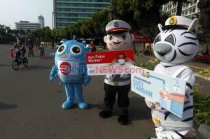 Boneka Cikpol Sosialisasi Protokol Kesehatan Covid-19 di Bundaran HI