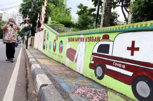 Mural Jalanan Ingatkan Masyarakat Patuhi Protokol Kesehatan
