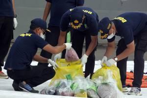 DVI Polri Periksa Baju dan Properti Milik Penumpang Sriwijaya Air SJ182