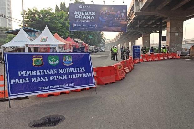 Petugas Jaga Berlapis di Tiga Titik, Arus Kendaraan dari Kalimalang Bekasi Menuju Jakarta Sepi