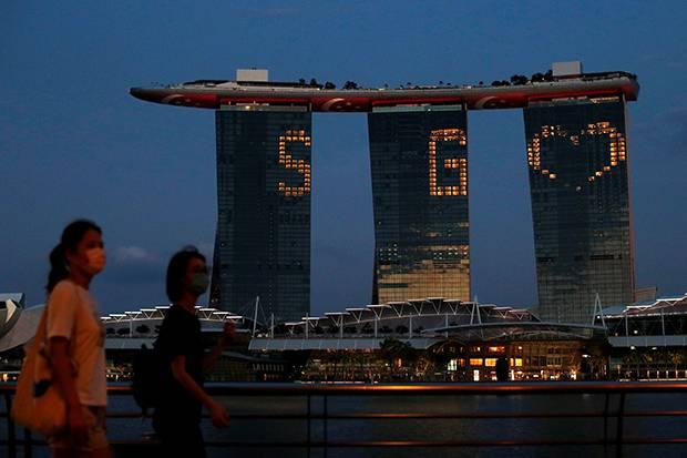 Singapura: Peningkatan Kasus Tidak Ubah Rencana Perlakukan Covid-19 sebagai Flu Biasa