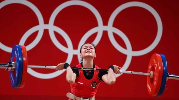 Sumbang Medali Pertama, Begini Potret Perjuangan Atlet Angkat Besi Indonesia Windy Cantika Saat Berlaga di Olimpiade Tokyo 2020