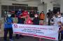 Bantuan Kemanusiaan, Donasi Konsumen Alfamidi Salurkan 300 Paket Sembako Peduli Banjir di Manado