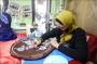 Jilbab dan Masker Lukis Jadi Primadona Jelang Lebaran