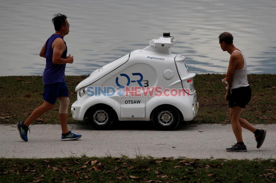 Singapura Gunakan Robot 0-R3 Ingatkan Warga untuk Jaga Jarak-1