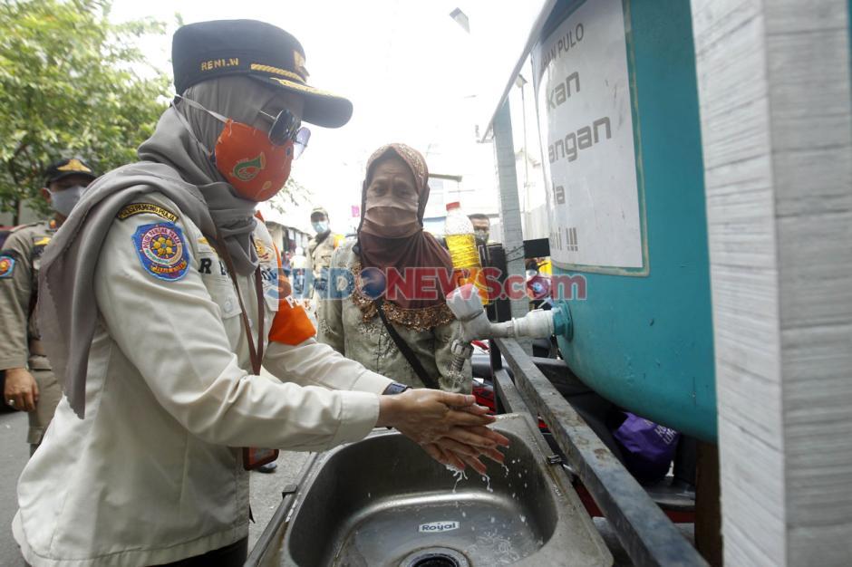 Satpol PP Pulo Gelar Patroli Protokol Kesehatan di Pasar Blok A-4