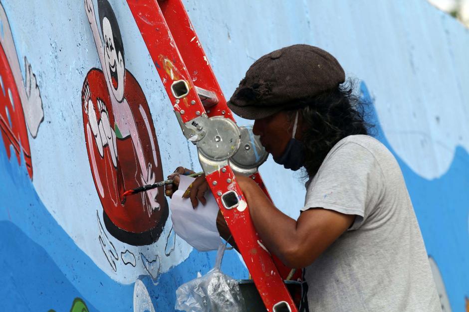 Percantik Kawasan Kali Ciliwung, Seniman Mural Angkat Tema Kehidupan Sungai-1