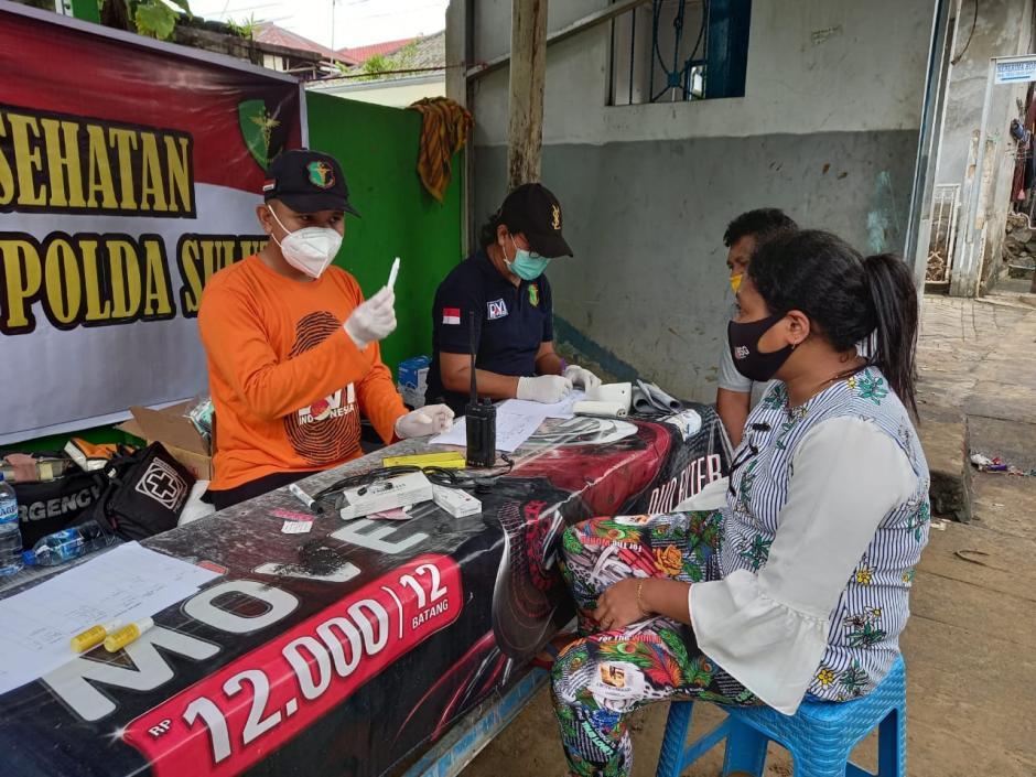 Peduli Korban Banjir Manado, Biddokkes Polda Sulut Gelar Pelayanan Kesehatan Gratis-0