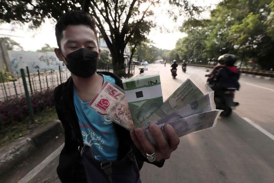 Jelang Lebaran, Jasa Penukaran Uang Jalanan Mulai Marak-0